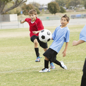 Boys playing soccer iStock_000022385490Medium