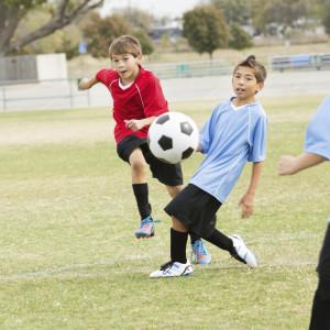 Boys playing soccer iStock_000022385490Medium