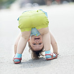 girl playing upside down